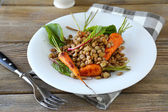 Lentils with carrots in bowl — Stock Photo