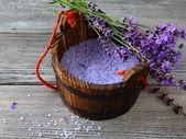 Aromatic bath salt in wooden bucket — Stock Photo