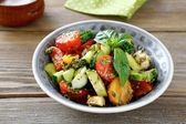 Salad with vegetables and pesto in bowl — Stock Photo