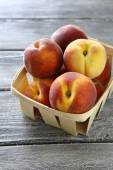 Juicy and fragrant peaches in  box — Stock Photo