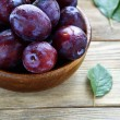 Freshly picked plums in a bowl — Stock Photo #53172055