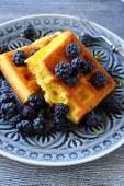 Golden waffles with black blackberries — Stock Photo