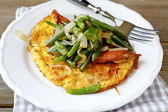 Omelet on a white plate — Stock Photo