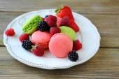 Wild berries with macaroon — Stock Photo