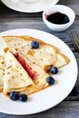 Crepes with blueberry jam — Stock Photo