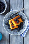 Waffles with fresh forest berries — Stock Photo