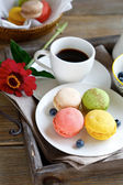 Delicious macaroon on a plate with coffee — Stock Photo