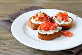 Crispy bruschetta with cheese — Stock Photo