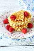 Stack of crispy waffles with raspberries — Stock Photo
