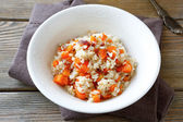 Steamed rice with carrots in a white bowl — Stok fotoğraf