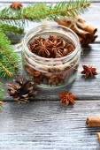 Aromatic anise and cinnamon with pine branches on the boards — Stock Photo