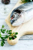 Fresh dorado on a cutting board — Stock Photo