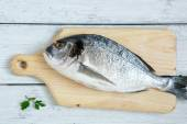 Raw Dorade with parsley and lemon pepper — Stock Photo