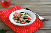 Couscous with tomatoes and olives — Stock Photo