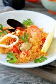 Risotto with mussels and squid meat plate — Stock Photo