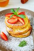 French toast with strawberries and icing sugar — Stock Photo