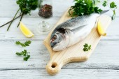 Fresh dorade with parsley and pepper — Stock Photo