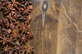 Aromatic anise on a wooden board — Stock Photo