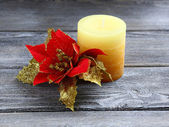Scented candle with Christmas flower — Stock Photo