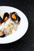 Delicious rice with cheese risotto and mussels — Stock Photo