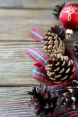 Dry Christmas pine cone with a ribbon — Stock Photo