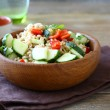 Pearl barley with cucumbers and pepper in a wooden bowl. Salad — Stock Photo #54803969