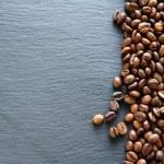 Fragrant fried coffee beans on a slate — Stock Photo #54899765
