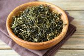 Green Tea leaves in a bowl — Stock Photo
