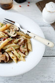 Pasta penne with pieces of mushrooms — Stock Photo