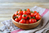 Sweet cherry tomatoes in a bowl — Stock Photo