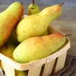 Sweet pears in a wooden box — Stock Photo #55232067