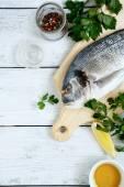 Dorado fish with lemon, olive oil and herbs — Stock Photo