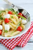 Pasta penne with cherry tomatoes and mozzarella cheese — Stock Photo