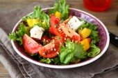 Salad with tomatoes, cheese and greens — Foto de Stock