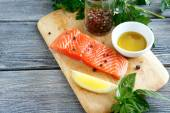 Raw fresh fish on a wooden board — Stock Photo