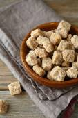 Sugar cubes in a small wooden bowl — Stockfoto
