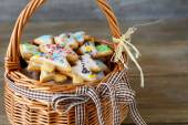 Icing sweet cookies in a basket — Stock Photo