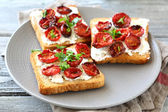 Bruschetta with sun-dried tomatoes and cheese — Stock Photo