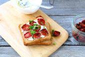 Italian bruschetta with sun-dried tomatoes and cheese — Stock Photo