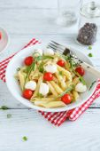 Penne with mozzarella and cherry tomatoes — Stock Photo