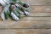 Xmas fir branch with cones on boards — Stock Photo