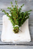 Fragrant thyme on cutting board — Stock Photo