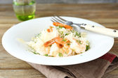 Tasty risotto with shrimp and dill on white plate — Стоковое фото