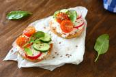 Bruschetta with tomatoes and cucumbers — Stock Photo