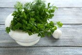 Parsley and dill in a mortar — Стоковое фото
