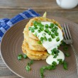 Fried potato pancakes with sour cream — Stock Photo #56839219