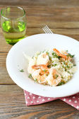 Risotto with shrimp and dill on a plate — Стоковое фото