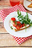Crispy bruschetta on a plate — Stock Photo