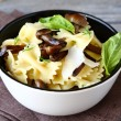 Farfalle pasta with mushrooms and cheese — Stock Photo #57791977