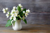 Jasmine in a vase on the boards — Stock Photo
